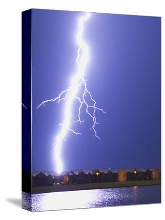 Lightning Striking an Apartment Complex-Jim Reed-Stretched Canvas Print