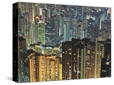 Apartment buildings in Hong Kong at night-Rudy Sulgan-Stretched Canvas Print