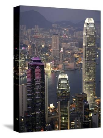 Hong Kong skyline and Victoria Harbor at night-Tibor Bogn?r-Stretched Canvas Print
