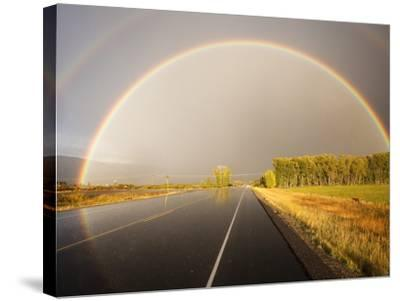 Double rainbow on country road in autumn-Frank Lukasseck-Stretched Canvas Print