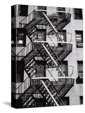 Fire Escape on Apartment Building-Henry Horenstein-Stretched Canvas Print