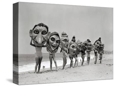 Women Holding Giant Masks-Bettmann-Stretched Canvas Print