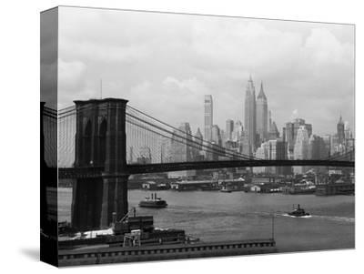Manhattan Skyline And Brooklyn Bridge-Bettmann-Stretched Canvas Print