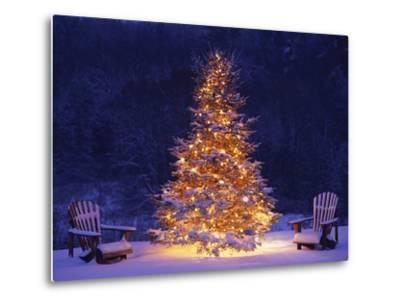 Snow Covering Adirondack Chairs by Lit Christmas Tree-Jim Craigmyle-Metal Print