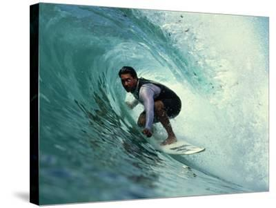 Professional Surfer Riding a Wave-Rick Doyle-Stretched Canvas Print