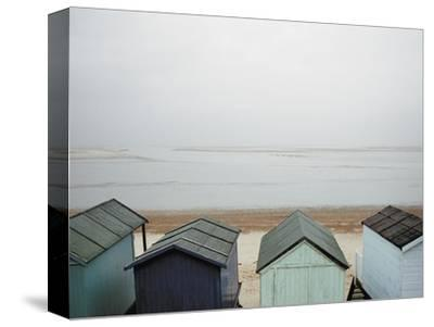 Cabanas on Empty Beach--Stretched Canvas Print