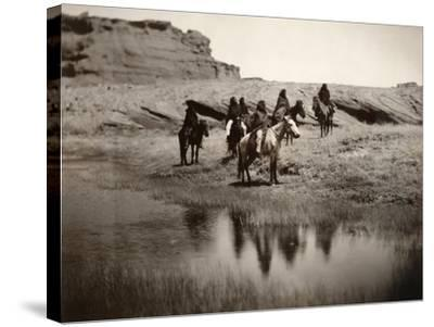 Navajo On Horseback, C1904-Edward S^ Curtis-Stretched Canvas Print