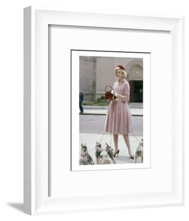 Glamour - October 1959 - Woman Walking a Pack of Dogs-Sante Forlano-Framed Premium Photographic Print