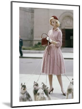 Glamour - October 1959 - Woman Walking a Pack of Dogs-Sante Forlano-Mounted Premium Photographic Print