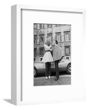 Vogue - April 1969 - Veruschka Adjusts Tomas Milian's Cape-Franco Rubartelli-Framed Premium Photographic Print
