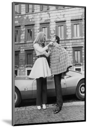Vogue - April 1969 - Veruschka Adjusts Tomas Milian's Cape-Franco Rubartelli-Mounted Premium Photographic Print