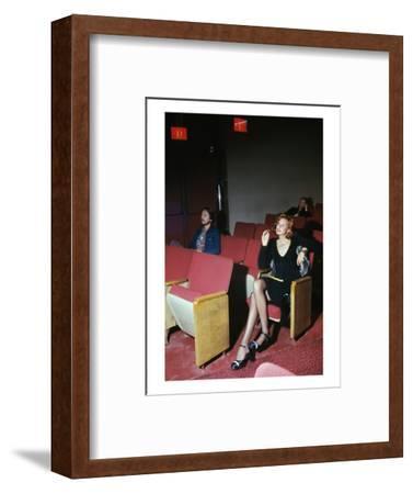 Vogue - September 1972 - Woman in Movie Theater-Kourken Pakchanian-Framed Premium Photographic Print