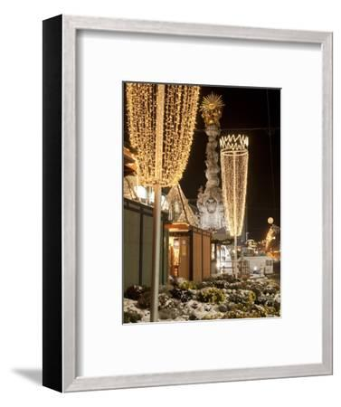 Snow-Covered Flowers, Christmas Decorations and Baroque Trinity Column at Christmas Market, Austria-Richard Nebesky-Framed Photographic Print