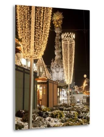 Snow-Covered Flowers, Christmas Decorations and Baroque Trinity Column at Christmas Market, Austria-Richard Nebesky-Metal Print