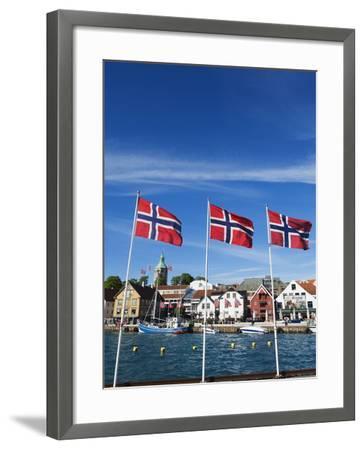 Norwegian Flags and Historic Harbour Warehouses, Stavanger, Norway, Scandinavia, Europe-Christian Kober-Framed Photographic Print