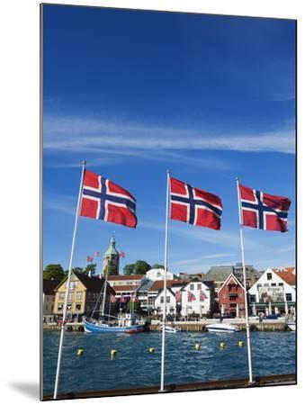 Norwegian Flags and Historic Harbour Warehouses, Stavanger, Norway, Scandinavia, Europe-Christian Kober-Mounted Photographic Print