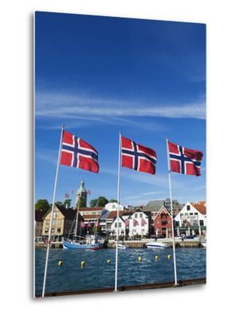 Norwegian Flags and Historic Harbour Warehouses, Stavanger, Norway, Scandinavia, Europe-Christian Kober-Metal Print