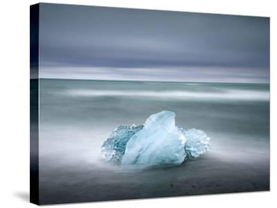 Piece of Glacial Ice Washed Ashore By the Incoming Tide Near Glacial Lagoon at Jokulsarlon, Iceland-Lee Frost-Stretched Canvas Print