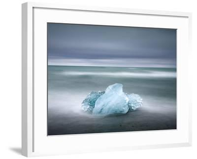 Piece of Glacial Ice Washed Ashore By the Incoming Tide Near Glacial Lagoon at Jokulsarlon, Iceland-Lee Frost-Framed Photographic Print