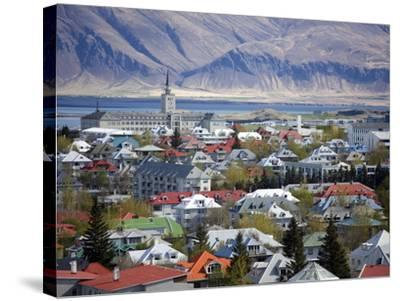 View Over Reykjavik With Mountains Looming in the Distance, Reykjavik, Iceland, Polar Regions-Lee Frost-Stretched Canvas Print