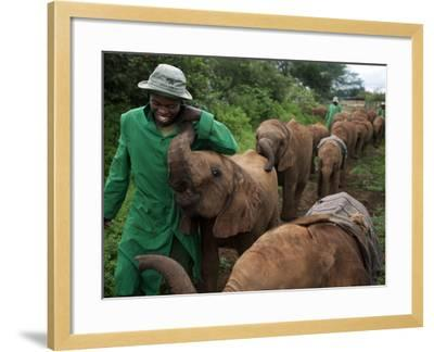 Elephant Orphans Form Intense Bonds With Their Caregivers and Vice Versa-Michael Nichols-Framed Photographic Print