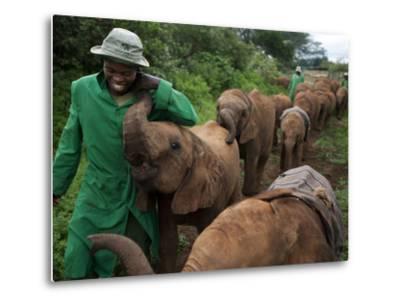 Elephant Orphans Form Intense Bonds With Their Caregivers and Vice Versa-Michael Nichols-Metal Print
