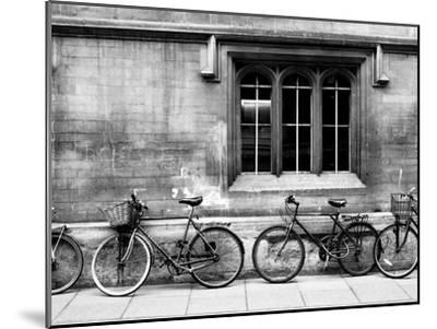 A Row of Bikes Leaning Against an Old School Building in Oxford, England-Keith Barraclough-Mounted Photographic Print