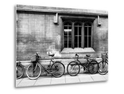 A Row of Bikes Leaning Against an Old School Building in Oxford, England-Keith Barraclough-Metal Print