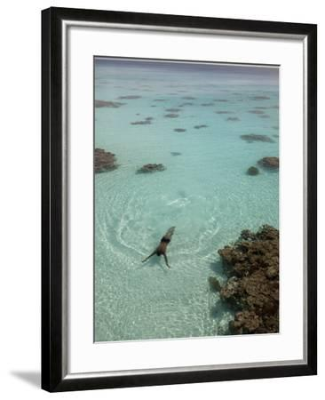 A Swimmer at a Resort on the Fakarava Atoll-Aaron Huey-Framed Photographic Print