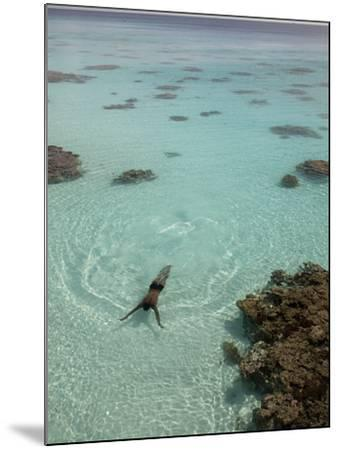A Swimmer at a Resort on the Fakarava Atoll-Aaron Huey-Mounted Photographic Print