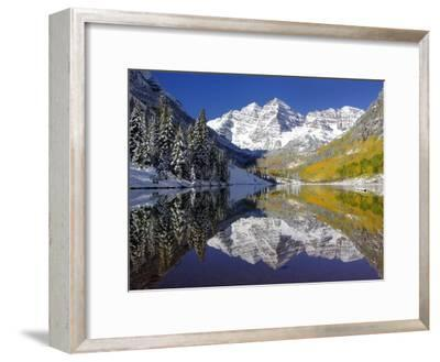The Maroon Bells Casting Reflections in a Calm Lake in Autumn-Robbie George-Framed Premium Photographic Print