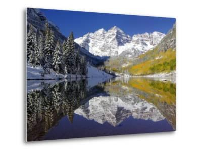 The Maroon Bells Casting Reflections in a Calm Lake in Autumn-Robbie George-Metal Print