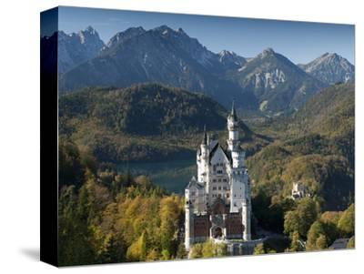 Romantic Neuschwanstein Castle and German Alps in Autumn, Southern Part of Romantic Road, Bavaria, -Richard Nebesky-Stretched Canvas Print