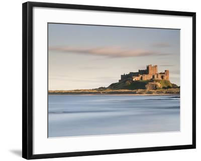 Bamburgh Castle Bathed in Golden Evening Light Overlooking Bamburgh Bay with the Sea Filling the Fo-Lee Frost-Framed Photographic Print
