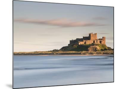 Bamburgh Castle Bathed in Golden Evening Light Overlooking Bamburgh Bay with the Sea Filling the Fo-Lee Frost-Mounted Photographic Print