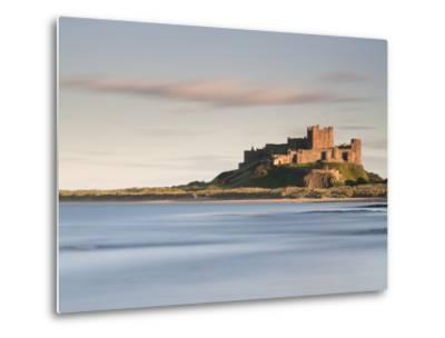 Bamburgh Castle Bathed in Golden Evening Light Overlooking Bamburgh Bay with the Sea Filling the Fo-Lee Frost-Metal Print
