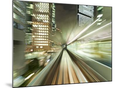 Asia, Japan, Honshu, Tokyo, Pov Blurred Motion of Tokyo Buildings from a Moving Train-Gavin Hellier-Mounted Photographic Print