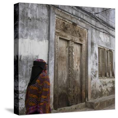Zanzibar, Tanzania. a Zanzibari Women in Traditional Khanga Robes, Passing an Old Wooden Door in St-Steve Outram-Stretched Canvas Print