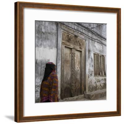 Zanzibar, Tanzania. a Zanzibari Women in Traditional Khanga Robes, Passing an Old Wooden Door in St-Steve Outram-Framed Photographic Print