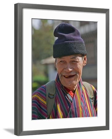 An Old Man at Trashigang Wearing the Traditional Gho Robe of All Bhutanese Men-Nigel Pavitt-Framed Photographic Print