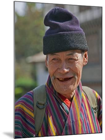 An Old Man at Trashigang Wearing the Traditional Gho Robe of All Bhutanese Men-Nigel Pavitt-Mounted Photographic Print