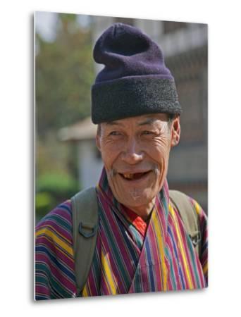 An Old Man at Trashigang Wearing the Traditional Gho Robe of All Bhutanese Men-Nigel Pavitt-Metal Print
