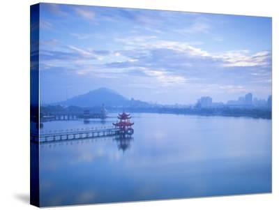 Taiwan, Kaohsiung, Lotus Pond, View of Bridge Leading to Spring and Autumn Pagodas with Statue of S-Jane Sweeney-Stretched Canvas Print