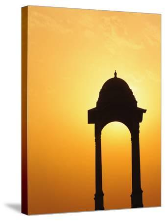Tower Near the India Gate Silhouetted at Sunset, New Delhi, India-Adam Jones-Stretched Canvas Print