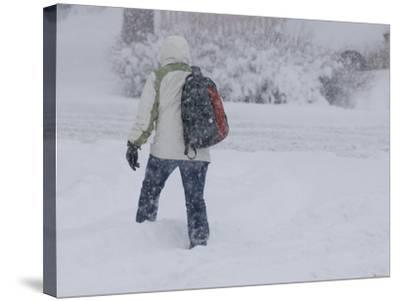A Pedestrian Walks Through Deep Snow Wearing Cold Weather Clothing During a Winter Storm-Jon Van de Grift-Stretched Canvas Print
