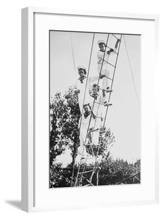 Crown Prince of Germany's Children Frolic on What Appears to Be a Ship's Ratline or Rope Ladder--Framed Art Print