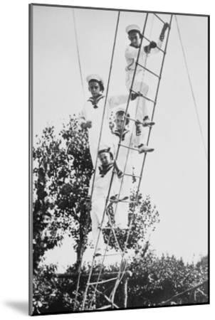Crown Prince of Germany's Children Frolic on What Appears to Be a Ship's Ratline or Rope Ladder--Mounted Art Print