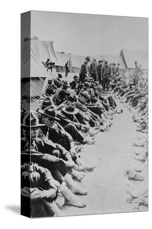 Foot Inspection, Soldiers Sit on Ground While Doctors Prepare to Examine a Full Unit at Once--Stretched Canvas Print
