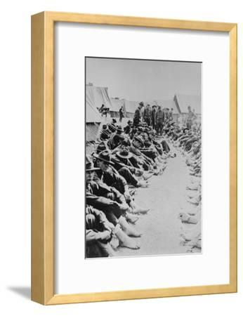 Foot Inspection, Soldiers Sit on Ground While Doctors Prepare to Examine a Full Unit at Once--Framed Art Print