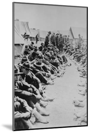 Foot Inspection, Soldiers Sit on Ground While Doctors Prepare to Examine a Full Unit at Once--Mounted Art Print